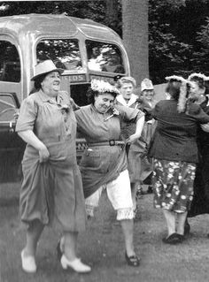 1954 England - women on a day trip. There may be more to this story than meets the eye!