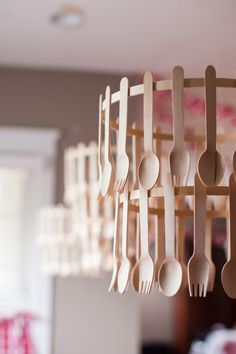 Diy wooden utensil chandeliers for a pizza or chef party