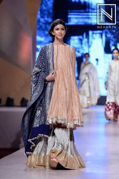Step in to this trending style of sporting a long #kurti over a #lehenga