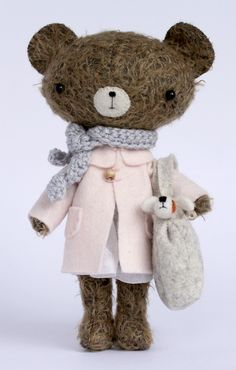 Such a stylish bear -- you can buy her cousins at http://manomine.bigcartel.com/