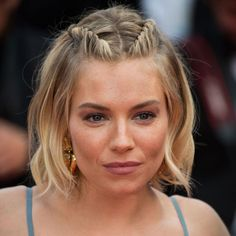 Sienna Miller stylishly camouflages her overgrown bangs with chic yet edgy French lace twist braids at the 2015 Cannes International Film Festival