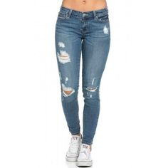 Slightly Ripped Low Rise Skinny Jeans ($40) ❤ liked on Polyvore featuring jeans, distressed jeans, stretchy jeans, torn skinny jeans, blue jeans and destroyed skinny jeans