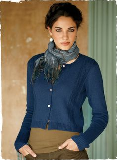 The cropped cardigan is knit of snuggly woolen-spun royal alpaca. Twisted cables trim the sides and extra-long, slim sleeves.