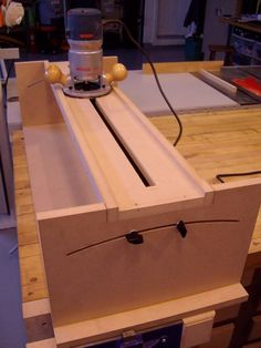 """Fingerboard Compound Radius Jig by LedBelli Bass -- Homemade fingerboard compound radius jig constructed from aluminum, MDF, and quartersawn oak. Intended for utilization in conjunction with a router. Accommodates fingerboards up to 36"""" long. http://www.homemadetools.net/homemade-fingerboard-compound-radius-jig"""