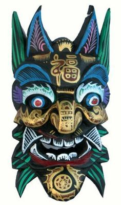 Chinese Wooden Mask- Joy by Hinky Imports. $27.99. This Chinese Mask is made from wood material. There are designs painted on the front of the mask. The Chinese symbol for joy is painted on the forehead of this mask. This mask is 10 inches long and 5 inches wide and was handmade in Xinjiang, western China.