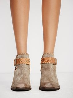 Walk The Line Ankle Boot | Western-inspired ankle boot featuring a square toe design and a chunky block heel. Side cutouts with an adjustable braided belt closure around the ankle. Padded footbed for a comfortable step.