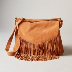 PRAIRIE SONG BAG -- Long, elegant fringe whispers of prairie wind in supple suede and earthbound shades. 2 inner pockets, 1 zips