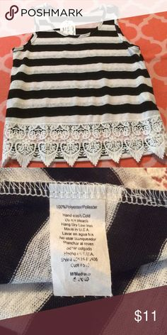 Must Have size medium sleeveless top This is a new, with tags attached, boutique brand Must Have size medium black and white striped sleeveless tank blouse with lace bottom. Fast shipping from a smoke free home. Offers and questions welcome. Thank you for looking. Must Have Tops Tank Tops