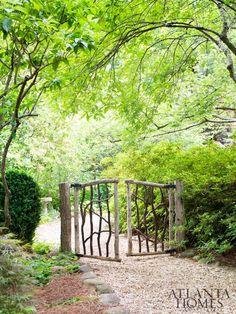 The rustic gate was made by Lake Rabun-based artisan Buz Stone.