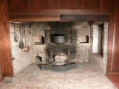 I have always wanted a big fireplace in my kitchen. Complete with hanging cauldron.