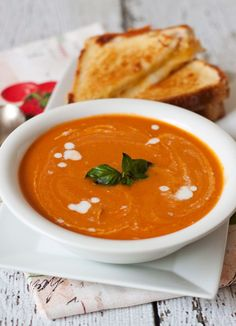 Homemade Creamy Tomato Basil Parmesan Soup made with fresh from the garden tomatoes and basil.