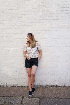 Sheer white floral top from Reiss paired with Zara leather shorts to create a  strong contrast between two different materials. Finishing off with a coral lipstick for a cool summer look | More on my blog
