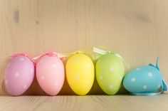 pastel colored easter eggs in a row
