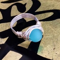 Catseye 💙Gemstone Wrap Ring Aqua Blue CatsEye Gemstone HandWrapped With Sterling Silver Plated Wire. 💙Custom Size🌼 Also available in Sterling Filled for $4 extra and Solid Sterling wire for $8 extra Jewelry Rings