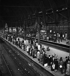 Paddington station crowded with people evacuating London ahead of rocket attacks, 1944.