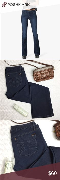 "Joe's Jeans Honey Bootcut in Mulholland/Dark wash - The Honey Bootcut in Mulholland is a dark indigo curvy bootcut jean with a contoured waistline and slightly more room in the thigh to compliment a woman's curves.  - Features shadow whiskers and hand-sanding for a casual, lived-in look.  - Only worn and washed once. Blue denim bled onto the tag during wash, but other than that these jeans are in perfect condition and are so flattering! Open to offers ;)  - Flat waist measures 16""  - 33.5""…"