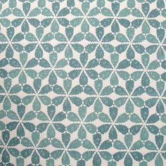 Maroc Fabric An eye-catching fabric in soft aqua with a simplified motif taken from the tiled decoration of a courtyard in Fez. The inks have been blended by hand during the printing process resulting in a subtle variation of shades across the pattern. Designed, manufactured and printed in the United Kingdom.
