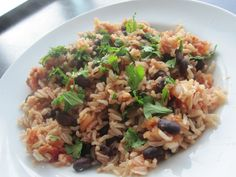 Rice and Beans: Super quick dinner idea! I combine 1 cup cooked brown rice with ½ cup canned black beans (rinsed & drained), ¼ cup salsa & 1-2 TB water just to mix everything through. Microwave until hot and garnish with optional cilantro. Easy and delish—great for a brown bag lunch, too! 345 cals, 13g protein, 12g fiber