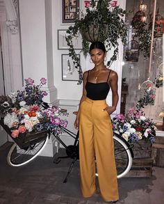 Simple tank and high waist wide leg trousers.