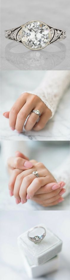 A beautiful Vintage Engagement Ring with a bezel set 2.18 carat old European cut diamond set in a platinum Art Deco setting with lots of detail!