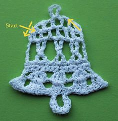 Crochet bell decoration with arrown to show direction of work