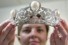 An employee shows the Murat Tiara at Sothebys auction house in Zurich, Switzerland. The pearl-and-diamond tiara was created for the marriage of a prince whose ancestors included the husband of Caroline Bonaparte, Napoleon's sister.