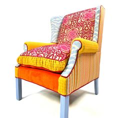 Former NASCAR driverShawna Robinsonhas married her passion for furniture with a love of risk-taking in her companyHappy Chair.Robinson imagines and creates over-the-top pieces like Blue Raspberry. This classic wingback is upholstered in blue zebra print and covered in bright scrolled-patterned velvet filled with orange, blues, and magentas. A sassy seat that's a delicious treat for the eyes, the checkered fabric in hues of orange, green, and blues makes the sides of this chair pop.