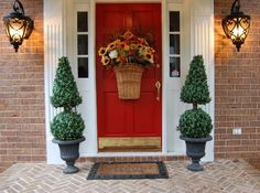 An Autumn Basket for the Front Door   I would try putting a 3 inch wide burlap ribbon around the top edge of the basket to visually shorten the basket.  Once you take away the urns and replace them with your stacked pumpkins it will look great.  Love your decorating.
