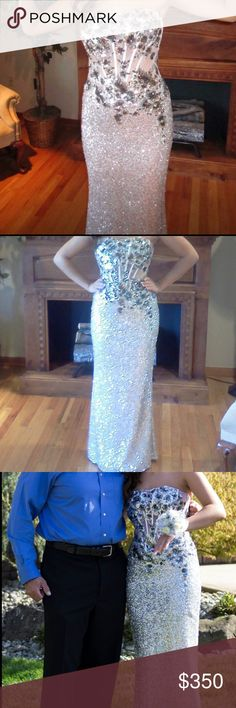 Silver sequin Faviana formal/ prom dress Silver sequin Faviana formal or prom dress Zipper in back  Floral design on top  Sweet heart neckline  A line Faviana Dresses Prom