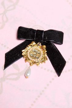 Plush Velvet Bow with signature Wheels & Dollbaby Bling Charm and Pearl Drop. Attaches with a pin-clasp. Approximate size: x Love To Shop, Vintage Glamour, Kate Moss, Gothic Lolita, Black Satin, Belly Button Rings, Vintage Items, Fashion Accessories, Velvet