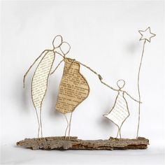 What a lovely little paper and wire sculpture