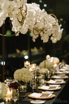 #Floral arrangement suspended above the head table.    Photography by Tara McMullen Photography   WedLuxe Magazine