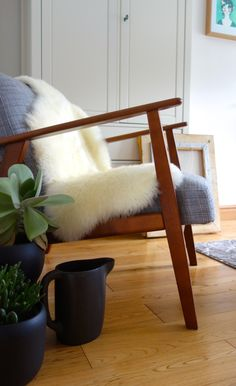 Ludde sheepskin rug on Ekenaset Ikea Armchair with Sinnerlig plant pots and Jug by Ilse Crawford