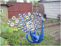 make-a-peacock-with-old-CDs-and-tire