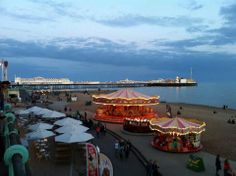 Carousels on Brighton Beach with the Palace Pier in the background