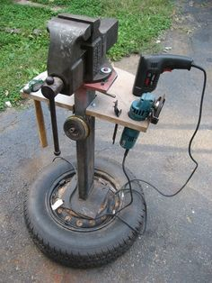 Homemade mobile vise and tool stand fashioned from a cement-filled spare tire, a wheel rim, rectangular tubing, and steel plate. Plywood platform provides a work area, as well as mounting space for power and hand tools. Woodworking Skills, Easy Woodworking Projects, Woodworking Shop, Woodworking Plans, Woodworking Workshop, Woodworking Magazine, Woodworking Software, Woodworking Beginner, Survival Tools