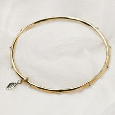 Palas Bangle - BANGLE WITH LEAF - Brass and Sterling Silver A bangle to wear with gold or silver jewellery - a shiny brass bangle with sterling silver features, including the signature leaf!