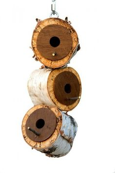 Bird houses made from birch tree trunks