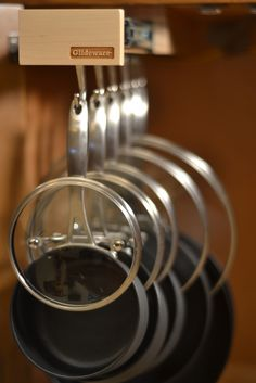 Hang your lids with your cookware.  www.Glideware.com