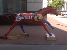 """A HOUSE DEVIDED"" – University of Louisville / University of Kentucky (Blue side of horse painted in University of Kentucky colors) University Of Louisville, Louisville Slugger, Louisville Kentucky, Kentucky Wildcats, Kentucky Derby, Best Basketball Shoes, Basketball Goals, Basketball Legends, Basketball Uniforms"