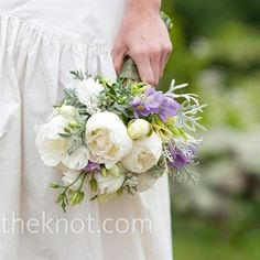 Kelly's bouquet of white peonies with purple and green accents enhanced the ceremony's garden vibe.
