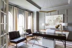 """Don't fear monochromatic palettes. """"Going gray from floor to ceiling creates a calming backdrop that allows this entire space to breathe, and I love how it highlights the newly paneled walls,"""" says Flanigan of a room that benefited from subduing the previously stark color contrast between the ceiling and walls."""