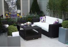 2 rattan garden chairs and coffee table in garden - Google Search