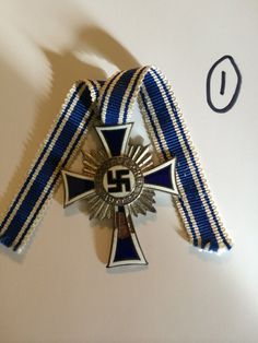 Bid on this German WW2 Enamel Mothers Cross in Silver, £30. Auction ends 27th Feb. http://www.bidonthis.co.uk/event/Yeovil-Auction-Rooms/eventless/German-WW2-Enamel-Mothers-Cross-in-Silver-slight-chip-to-the-enamel