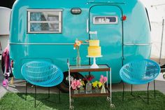 tiny turquoise vintage trailer. Love the chairs and the drink cart, too.