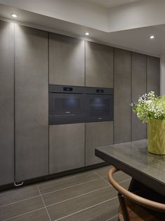Our recently renovated showroom featuring the latest Leicht Stone door finish and the new Miele Artline appliances. Completely handleless kitchen creating a smooth and clean facade. #HomeAppliancesShowroom