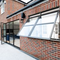 The homeowners of this property wanted to create a stronger connection between t. Casement Windows, Windows And Doors, Single Doors, Double Doors, Contemporary Windows, Bauhaus Style, Aluminium Windows, Open Window, Window Design