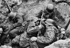 Waffen-SS in trenches.