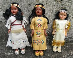 Native American dolls....My father bought me a little indian doll like the one in the middle from a trading post in the Smoky Mountains in Virginia.  I am fascinated by the memory of it to this day.  Especially the beading on the moccasins.