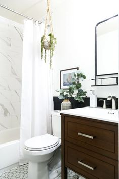 A modern and moody bathroom renovation with traditional touches - see how one couple transformed this bathroom in just 6 weeks #bathroom #renovation #bathroomrenovation #diy #diyproject #bathroomreno Budget Bathroom, Bathroom Renos, Bathroom Storage, Small Bathroom, Bathroom Ideas, Storage Hacks, Diy Room Decor, Home Decor, Clever Diy